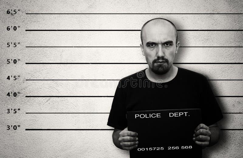 Arrested. Police mugshot of arrested criminal. Black and white image with copy space