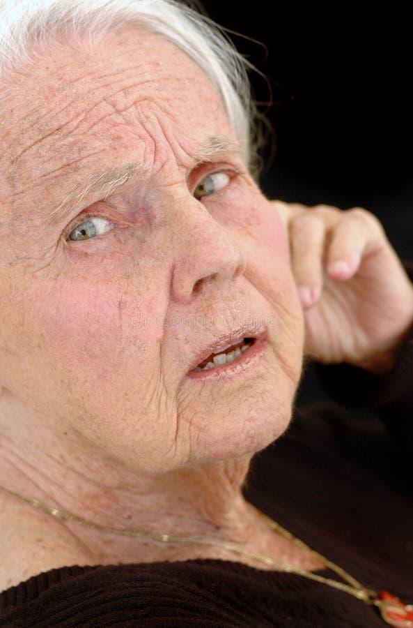 Arrière grand-mère perturbé photos stock
