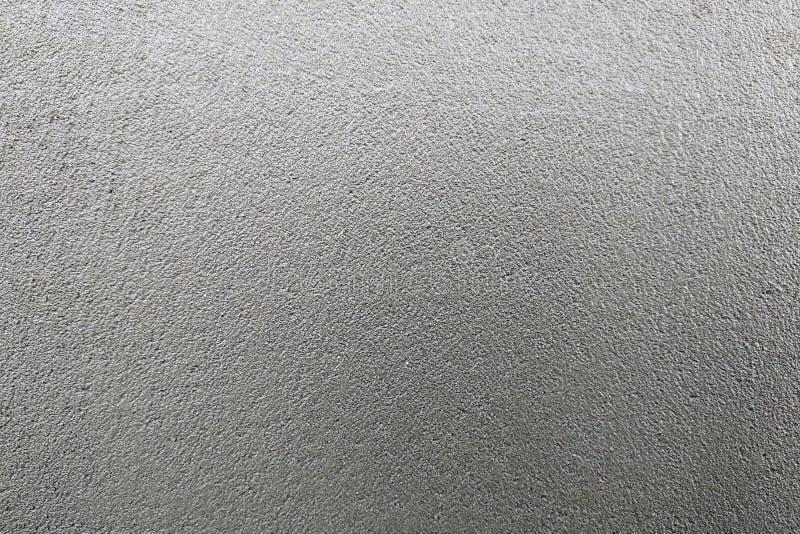 Arrière-plan texturé gris abstrait Mur recouvert de mortier de ciment photos stock