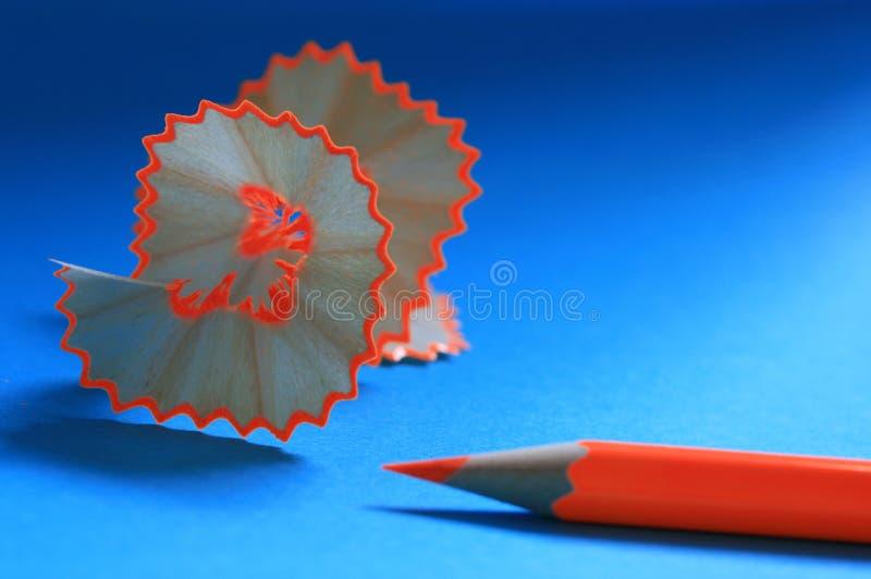 Arricciatura arancione di rasatura e della matita fotografia stock libera da diritti