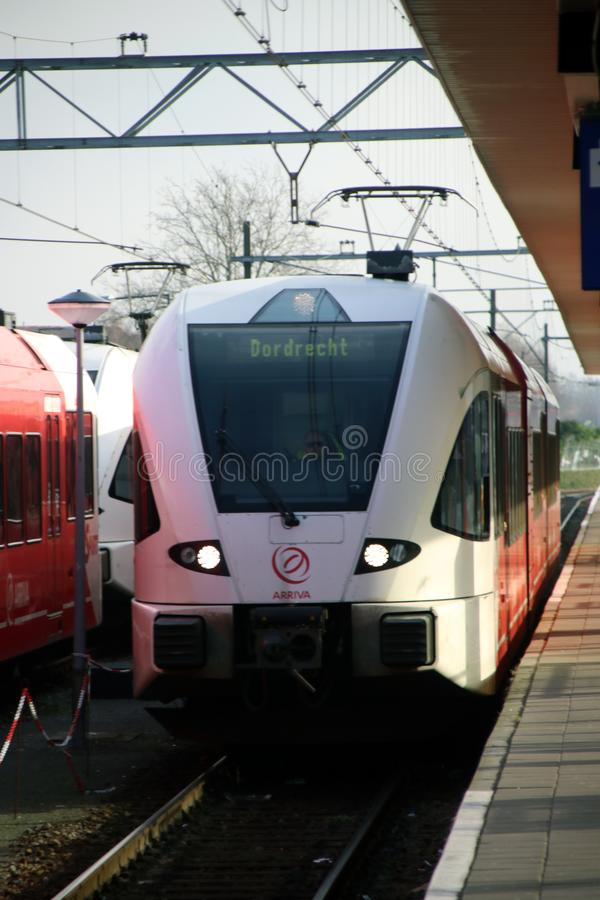 Arriva train type Flirt for local commuters at Dordrecht station along platform. royalty free stock images