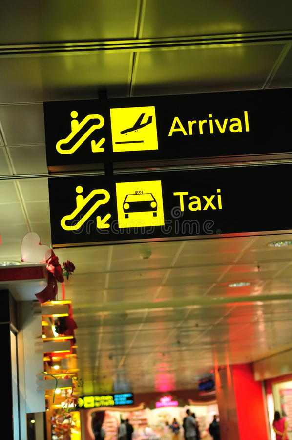 Arrival and taxi signs in airport royalty free stock photography