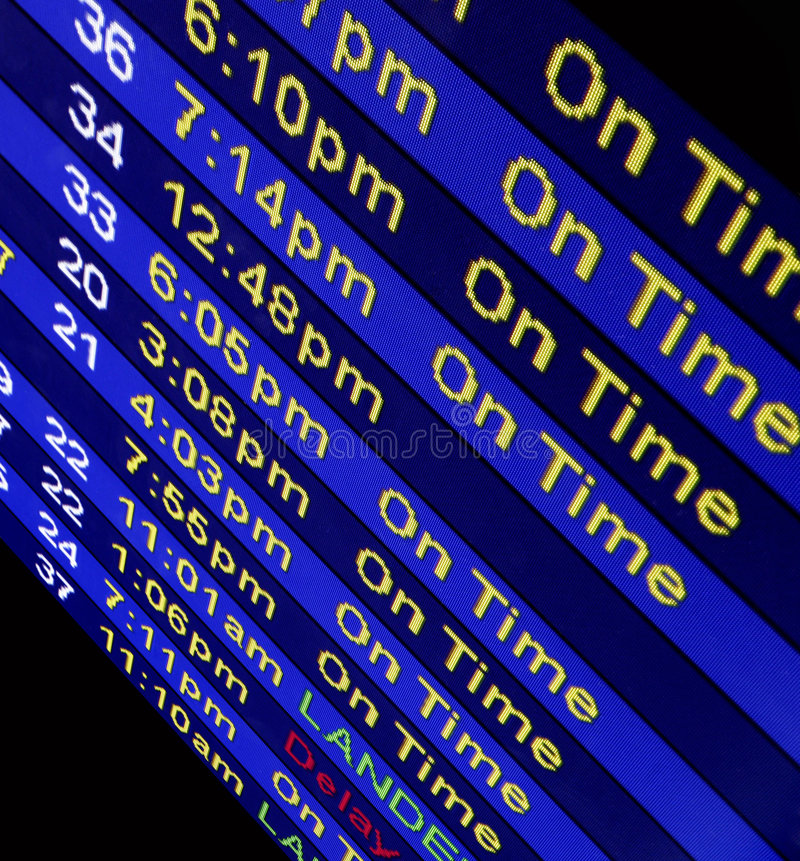 Arrival Times At An Airline Counter. Airline arrival times displayed on a computer monitor at an airport stock images