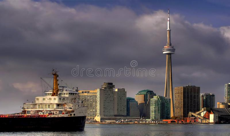 Arriving In Toronto Harbour. A large freighter pulling into Toronto Harbour on a lovely partly cloudy summer morning royalty free stock photography