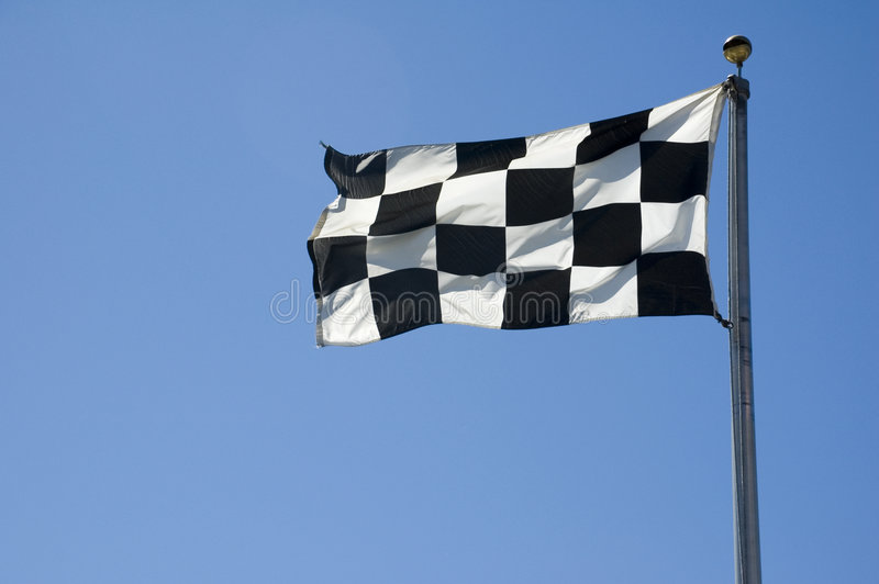 Arrivo Checkered bandierina su Palo fotografia stock libera da diritti