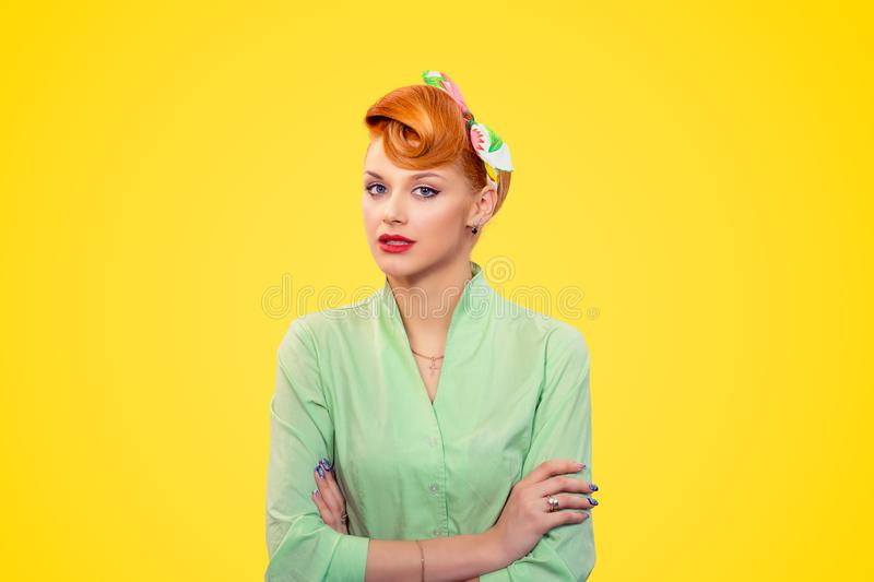 Pinup girl looking with arrogance at camera stock images