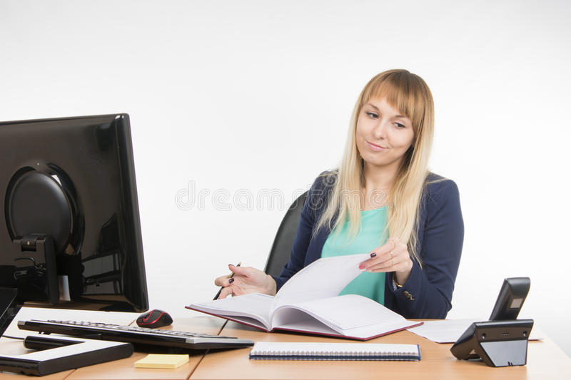 Arrogant office a specialist sorting paper looked at the phone rang. Young woman secretary sitting at office desk working, isolated on white background royalty free stock photos