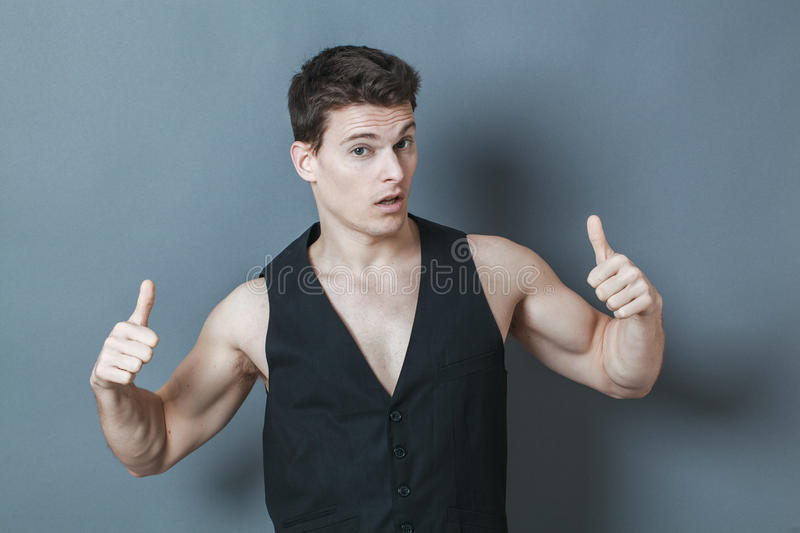 Arrogant sporty man with bare chest showing his muscles royalty free stock photo
