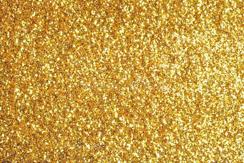 Arrosez le fond de la poussière d'or de scintillement images stock