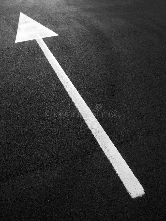 Arrow on asphalt royalty free stock photography