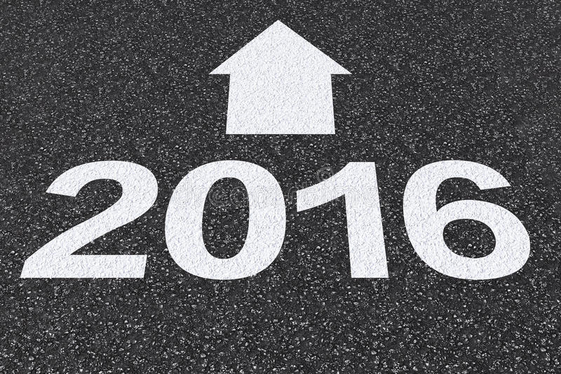 2016 with arrow on asphalt road stock images