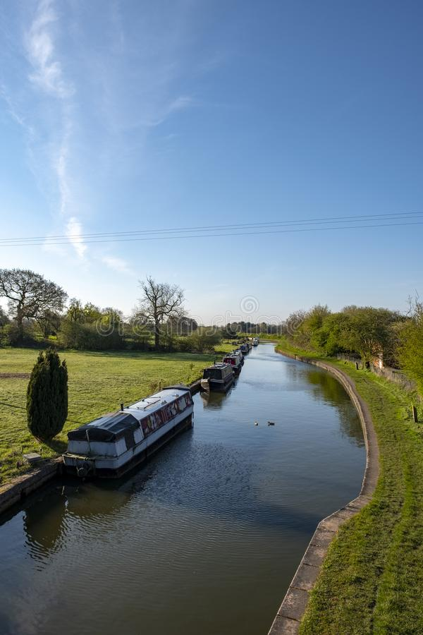 Narrow boats on the Trent and Mersey Canal in Cheshire UK stock image