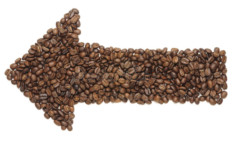 Arrow Coffee Beans. An arrow made of coffee beans isolated on white royalty free stock photo