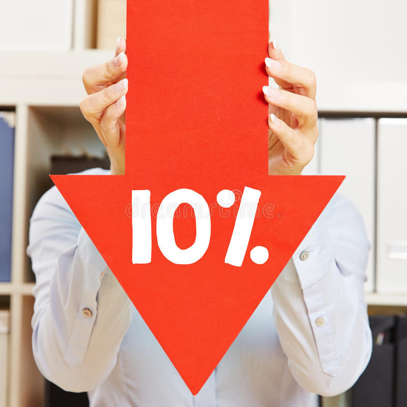 Arrow with 10% discount. Red arrow with 10% discount being held by female hands stock photography