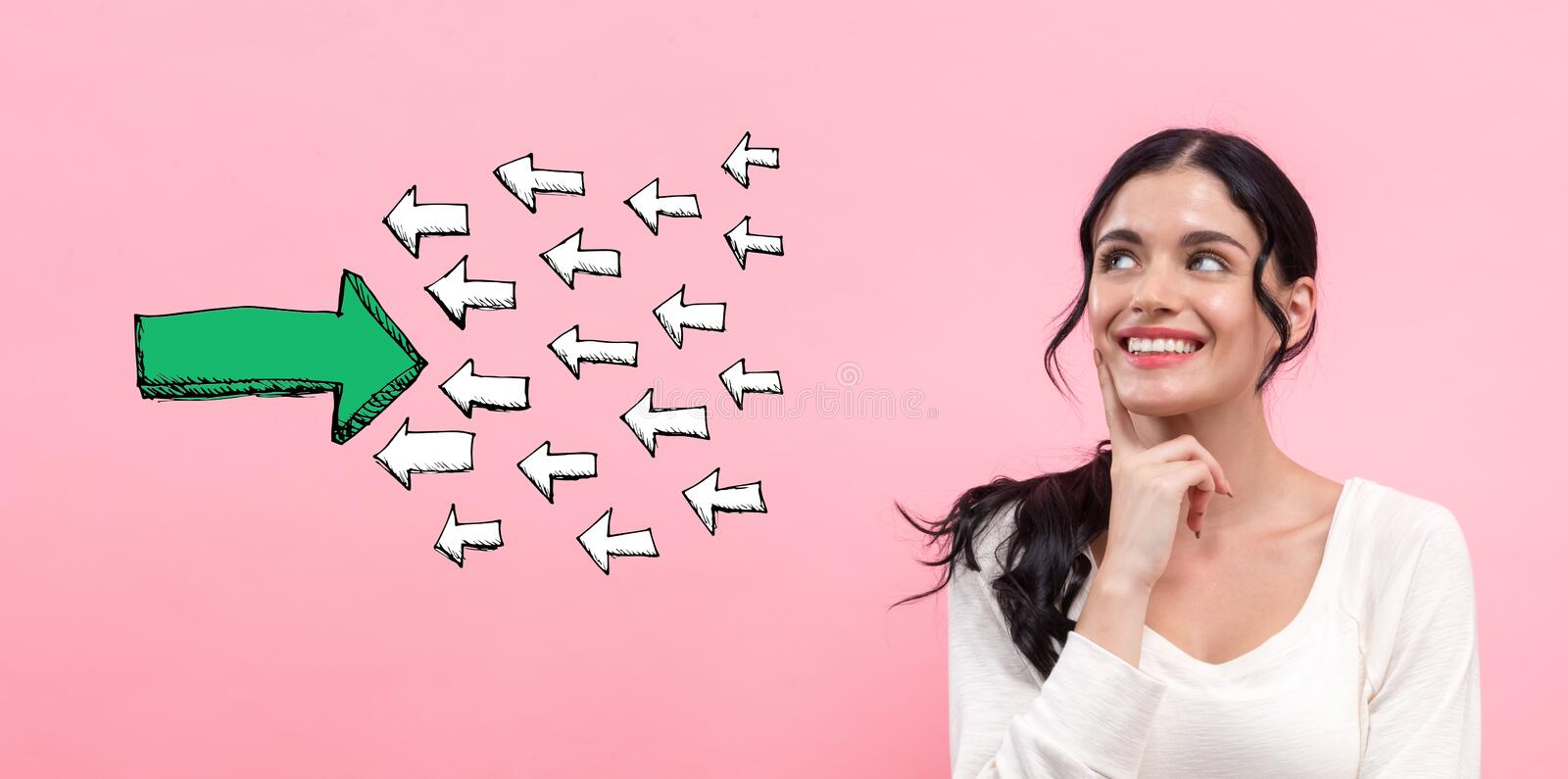 Arrow going in the opposite direction with young woman royalty free stock photo