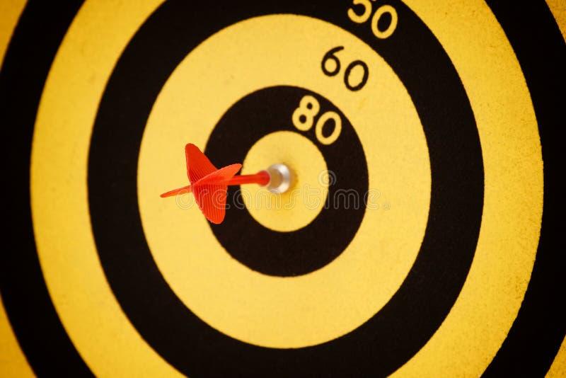Arrow Hit Black And Yellow Bullseye Stock Images