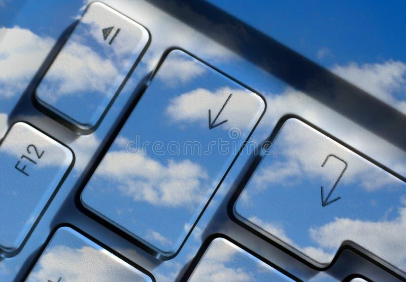 Arrow key with sky overlay royalty free stock photography