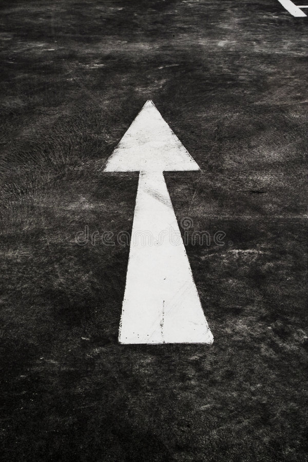 Arrow in pavement stock image
