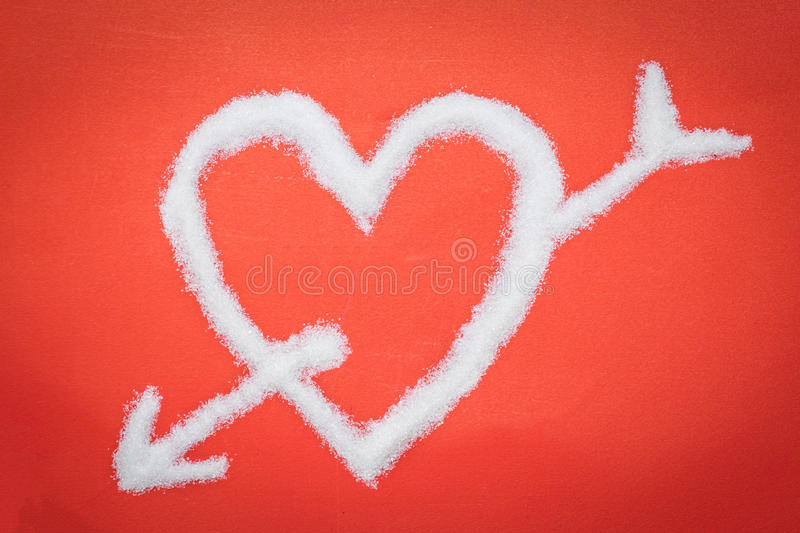 Arrow pierced my heart from sugar royalty free stock photo