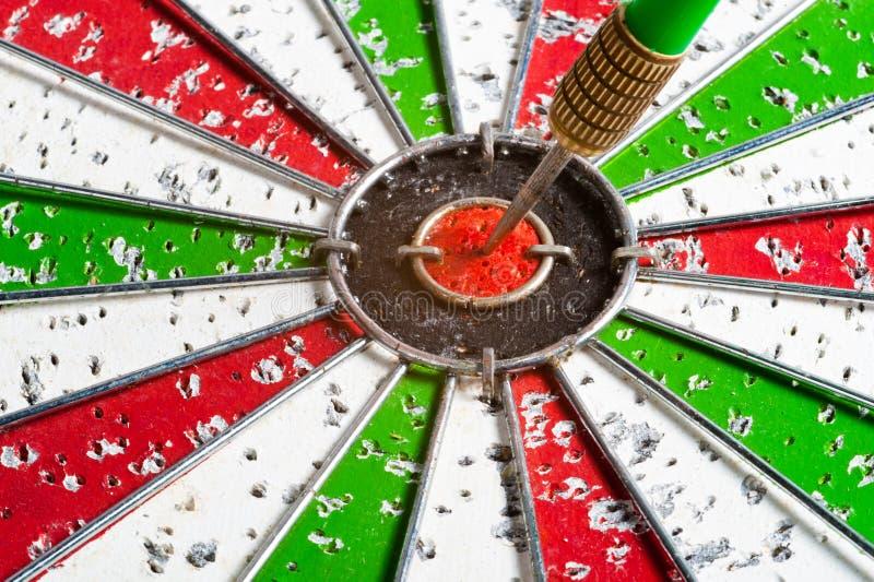 Arrow red & green bullseye dart board target game royalty free stock photography