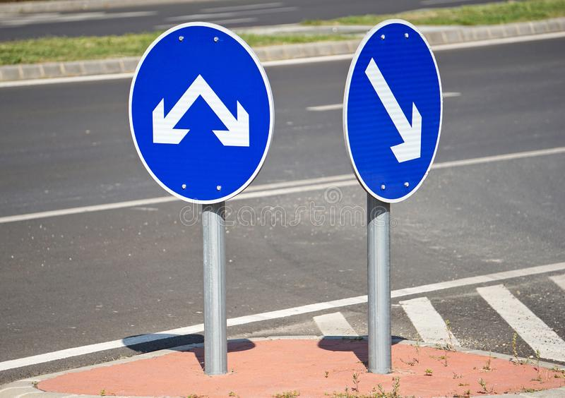 Arrow road signs at the road crossing. Outdoor royalty free stock photography