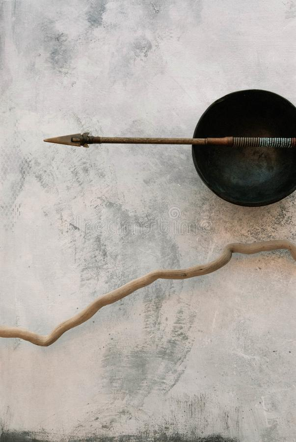 Totem Arrow Root and Ancient Pottery Bowl stock photo