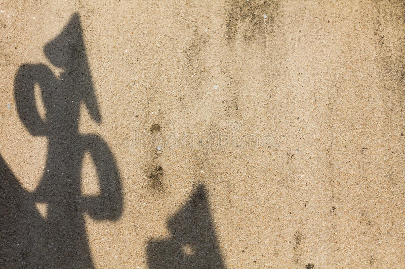 Arrow shadow on the wall. Arrow shadow on the concrete wall stock photo