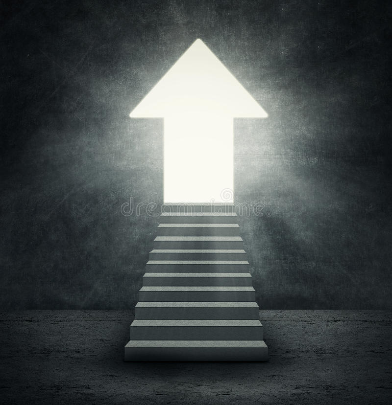 Arrow shaped door. With bright light symbolizing improvement or success royalty free stock photos