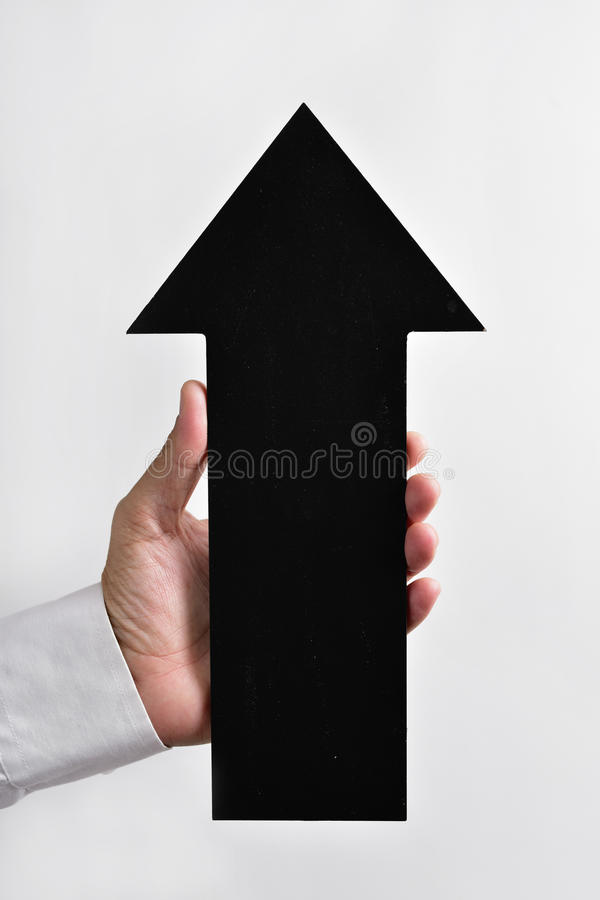 Arrow-shaped signboard pointing upwards stock images
