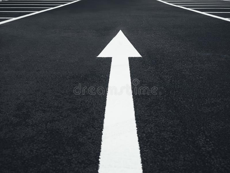 Arrow sign Direction on street background Conceptual royalty free stock image