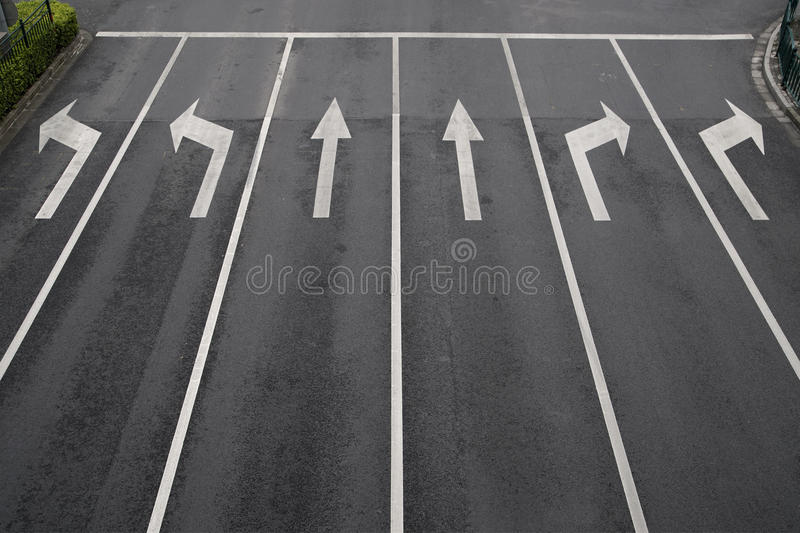 Arrow signs. As road markings on a street with six lanes royalty free stock photo