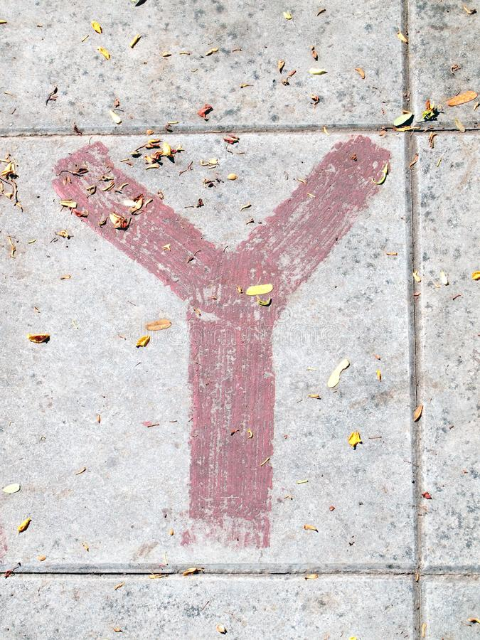 Arrow signs as road markings on a street. Close up royalty free stock image