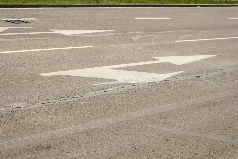 Arrow signs as road markings on a street, double arrows.  stock photo