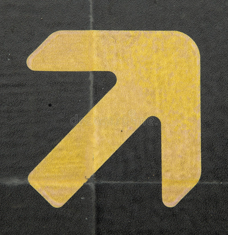 Arrow signs. Set of yellow arrow signs black background royalty free stock photo