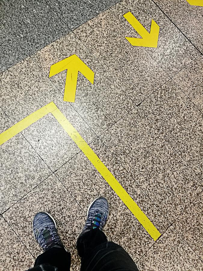 Arrow signs showing two different directions, in to out to stock image