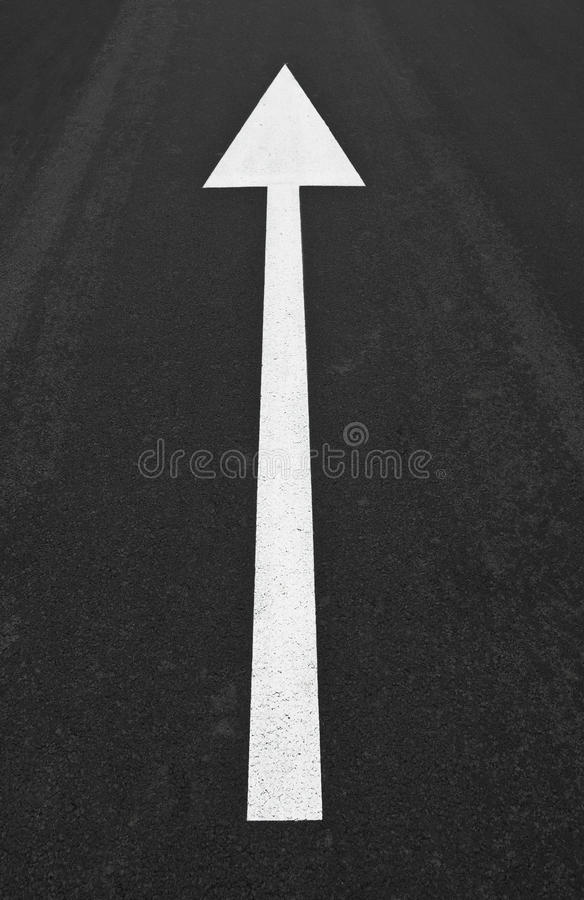 Arrow traffic sign painted on asphalt royalty free stock images