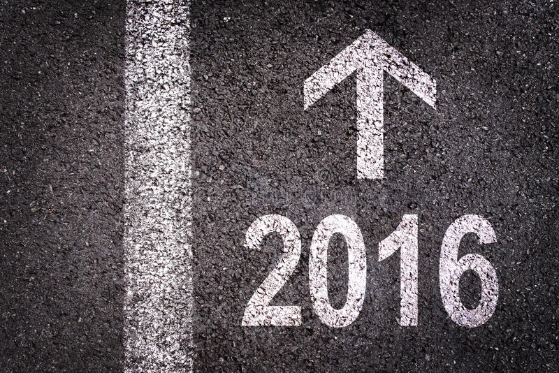 2016 and an arrow written on an asphalt road royalty free stock photography