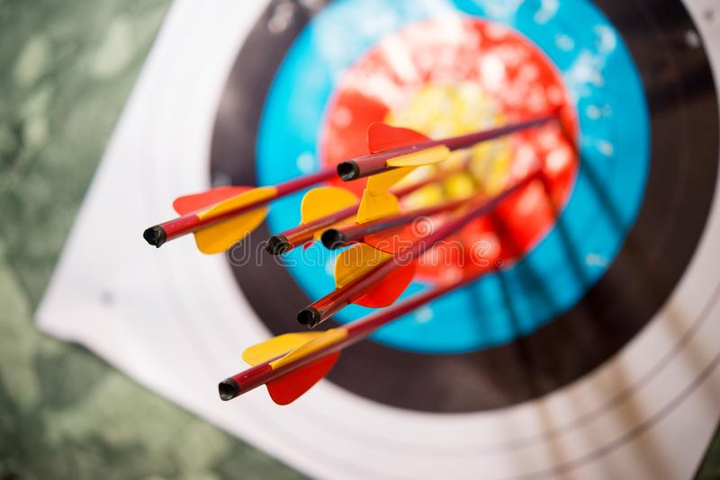 Arrows from a bow accurately hit the target. Arrows for archery hit the center of the target. Symbol skill, luck, movement towards the goal stock photos