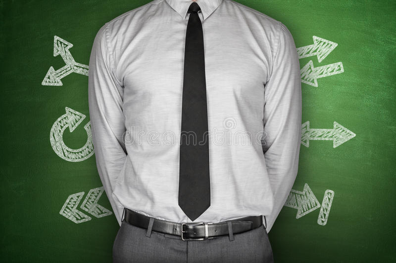 Arrows concept with businessman on Blackboard royalty free stock photos