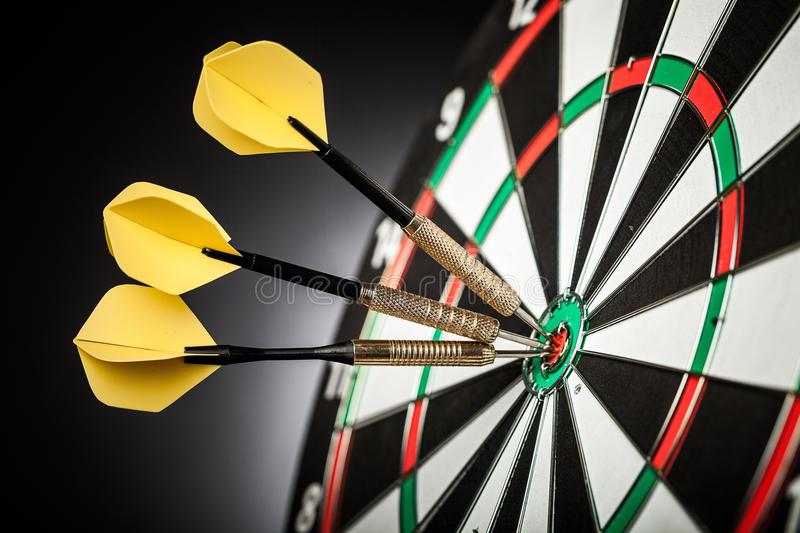 Dartboard with arrows on ackground. Arrows dartboard game games sport leisure color stock images