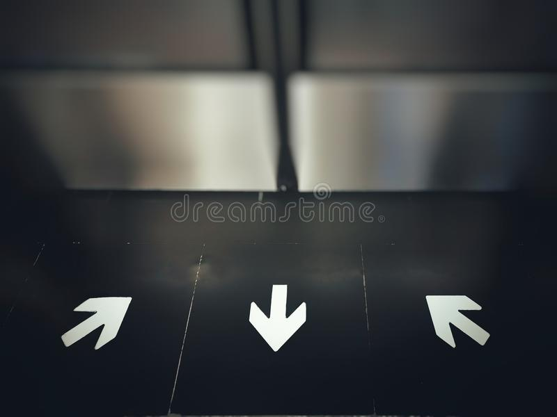 Arrows Direction Signs In And Out On Floor In Front Of Subway Door