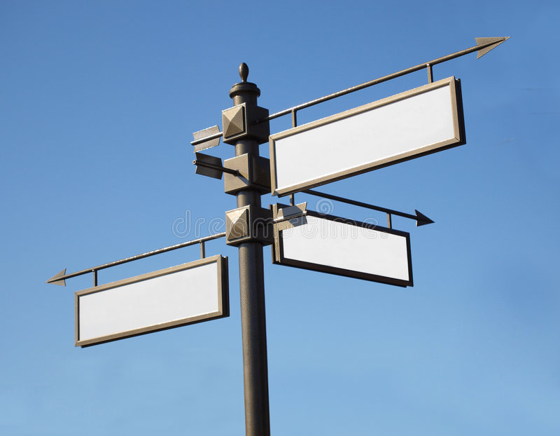 Arrows road signs. Color photo of road signs on a background of blue sky stock photos