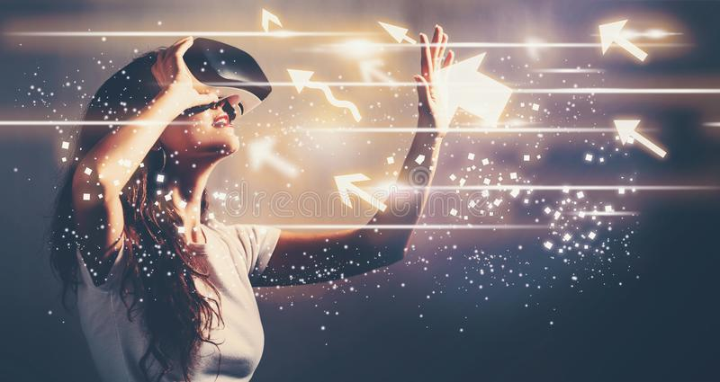 Arrows with young woman with VR. Arrows with young woman using a virtual reality headset stock photos