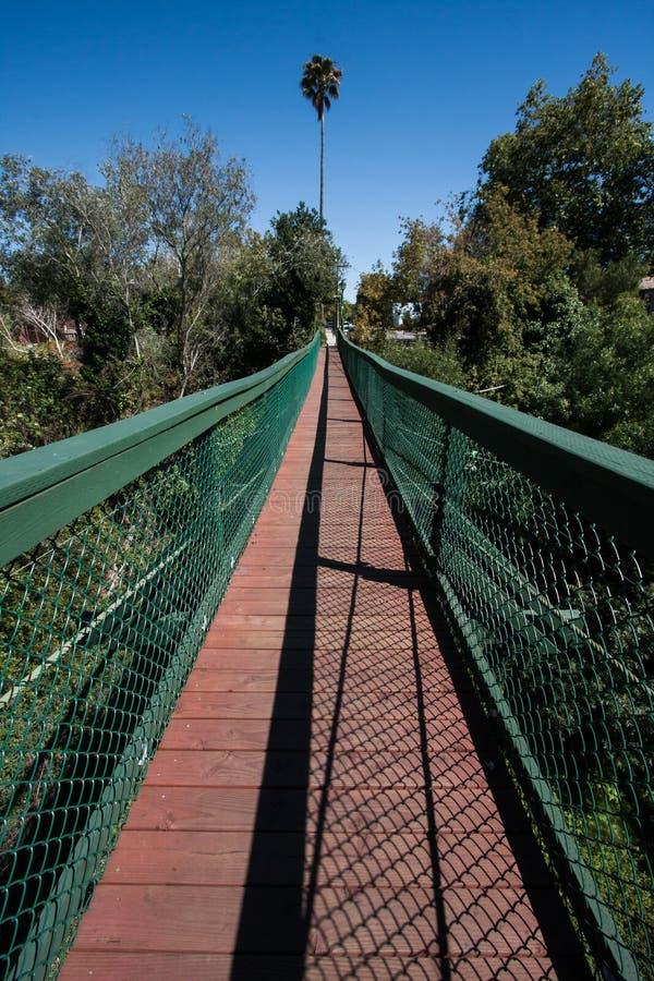 Arroyo Grande Suspension Bridge in California. View of beginning of the Arroyo Grande Creek Suspension Bridge which crosses Arroyo Grande Creek in the old stock photo
