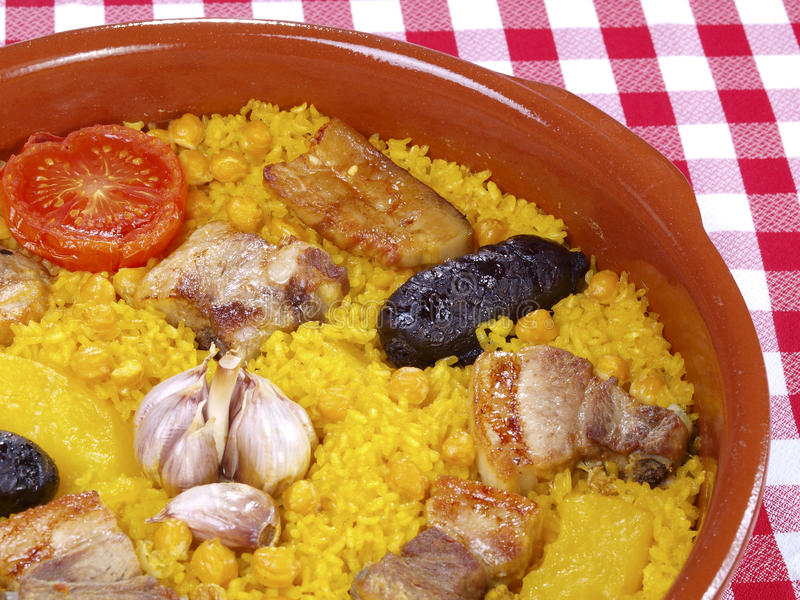Arroz al Horno – Oven cooked rice. Traditional Valencian Dish. The Paella is the most worldwide well-known Valencian dish, but the gastronomy in this royalty free stock image