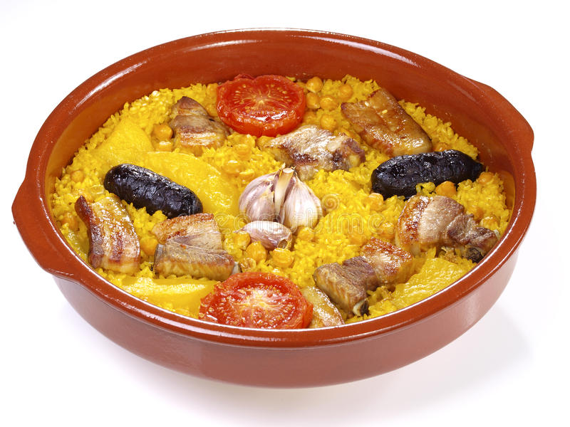 Arroz al Horno – Oven cooked rice - Isolated. Traditional Valencian Dish. The Paella is the most worldwide well-known Valencian dish, but the gastronomy royalty free stock photo