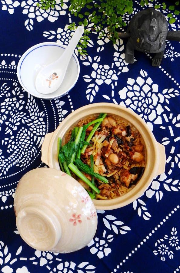 Arroz do potenciômetro de argila, prato étnico chinês fotos de stock