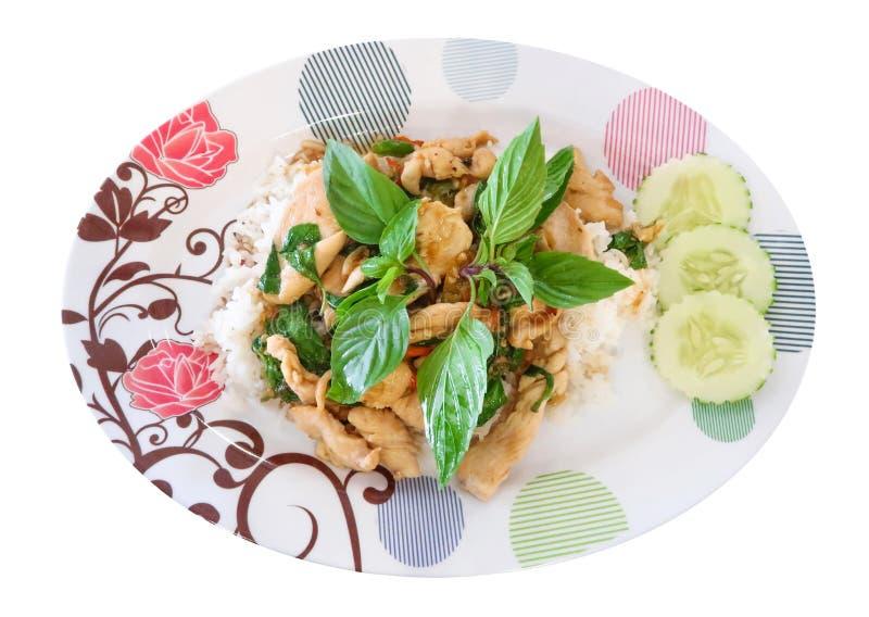 Arroz frito de la albahaca con el pollo en el fondo blanco foto de archivo libre de regalías