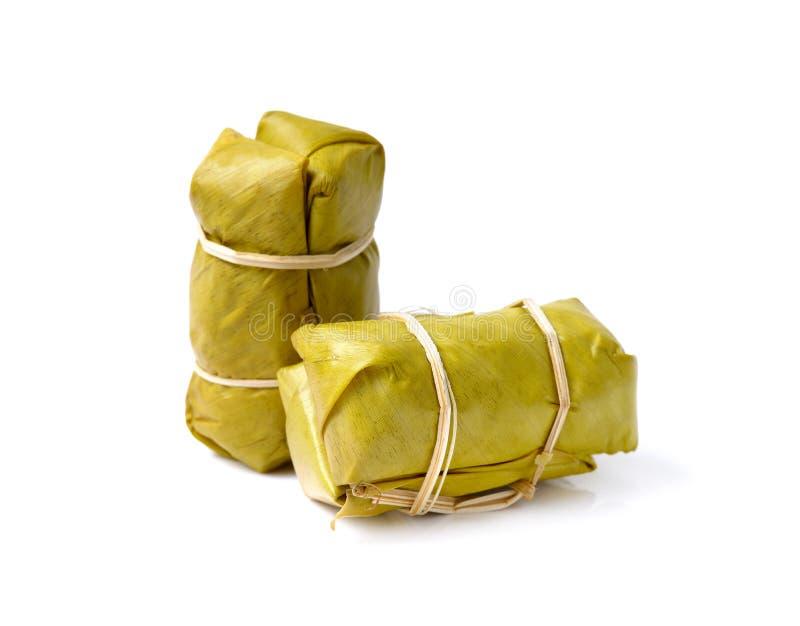 Arroz pegajoso tailandés dulce con el plátano, estilo tailandés tradicional de la comida, imagen de archivo libre de regalías