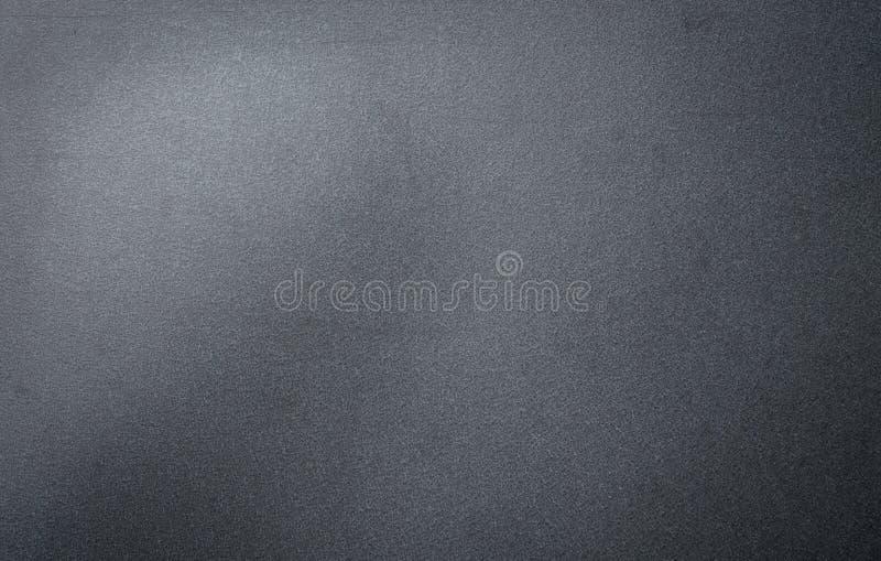 Arrugginito galvanizzi il fondo strutturato nero granulare del ferro immagine stock